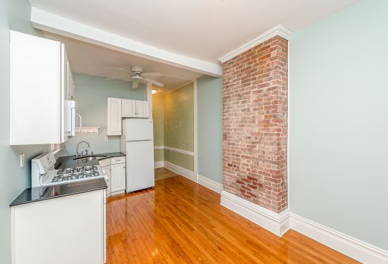 2nd Fl: 4 Rm Apartment - Granite Eat In Kitchen with Partial Brick Exposure Feature Wall