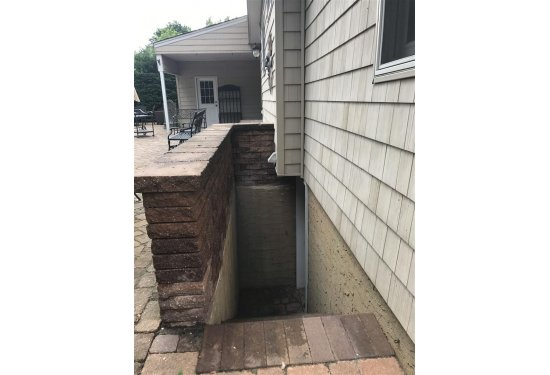 Backyard Basement access to storage/utility/laundry room