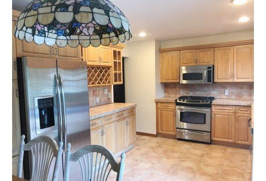 Delightful Eat In Kitchen with GE Profile SS Appliances & Breakfast Bar