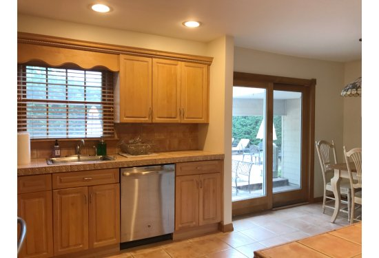 Delightful Eat In Kitchen with GE Profile SS Appliances & sliders to Backyard Patio Oasis
