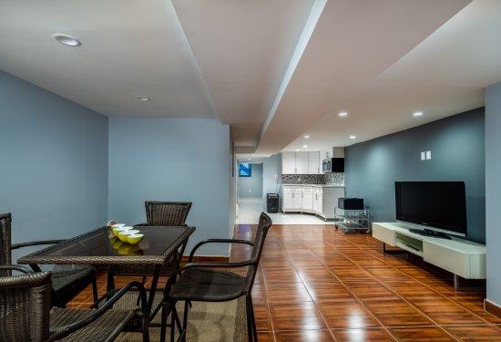 Fully Finished MINT Basement-Open Floorplan with Wet Bar, Full Bath, Recreation Room, Storage WalkIn Closet, Laundry Area, Utility Room