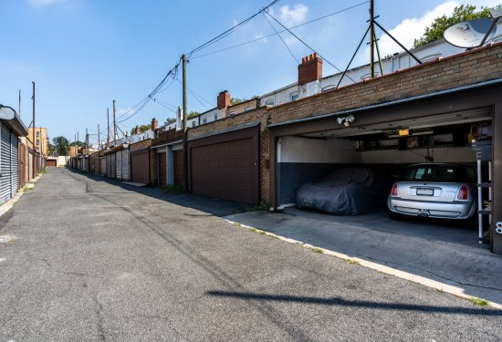 TWO Car Garage with access to Cozy Yard & Rear Access into Home
