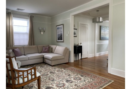Spacious & Sunny Living Room with Gas Fireplace & access to Window encased Sunroom