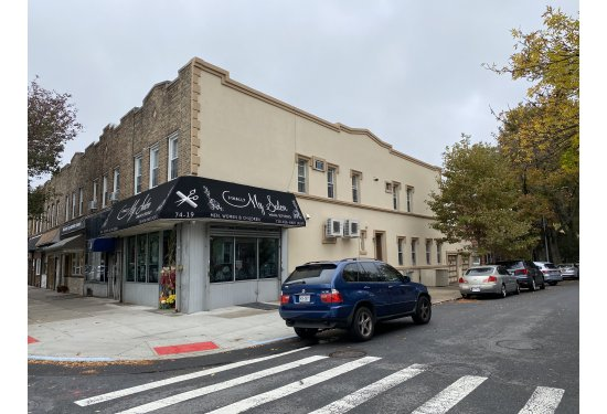 (2 Apartments+1Commercial Space+2 Garages)