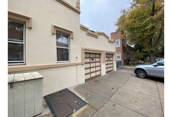 Corner Brick/Stucco Mixed Use (2 Res+1Commercial Space+2 Garages)