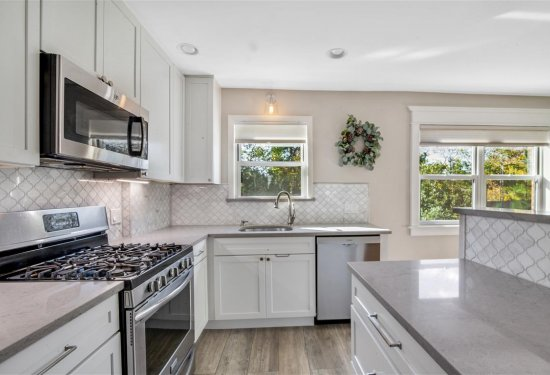"""Newly renovated Kitchen with 42"""" Cabinetry, Quartz Counters & SS Appliances"""