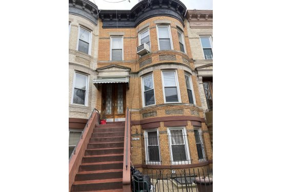 Triplex Brick Barrel Front Townhome located in the HEART of Ridgewood
